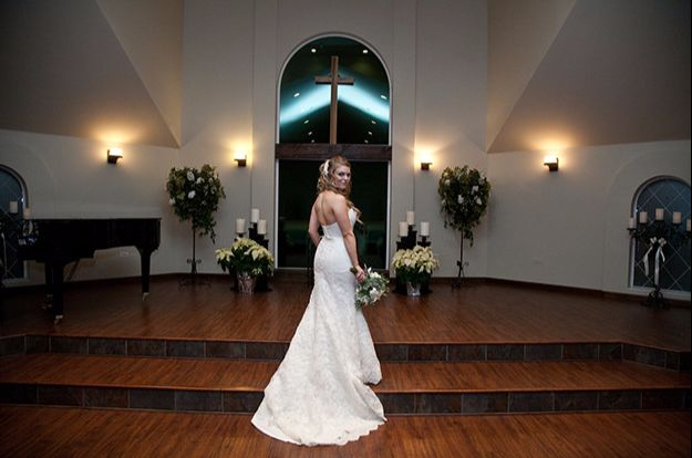 Bride at the steps inside our wedding chapel in Littleton, Colorado